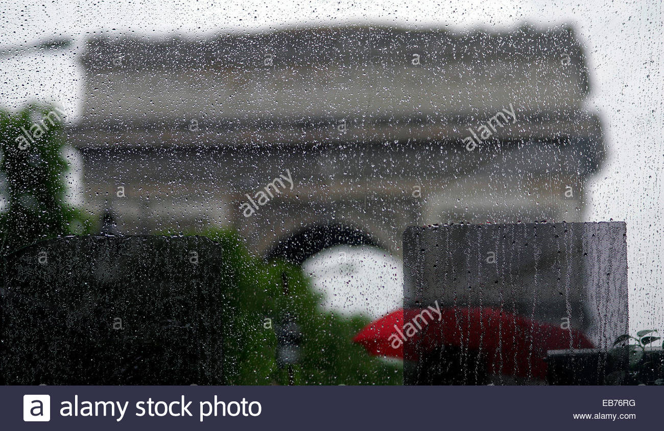 Raining day in Paris. The Arc de Triomphe behing a glass window, - Stock Image
