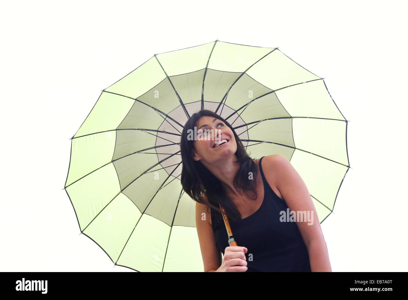 35 year old woman with umbrella. - Stock Image