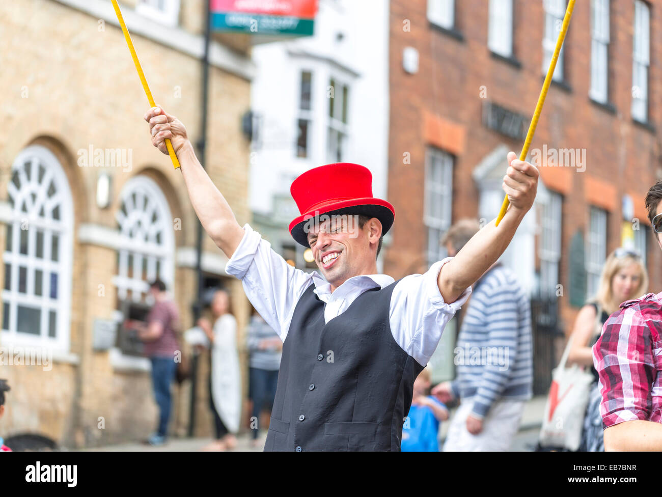 Man playing a soap bubble on high street at Arundel Festival 2014 Stock Photo
