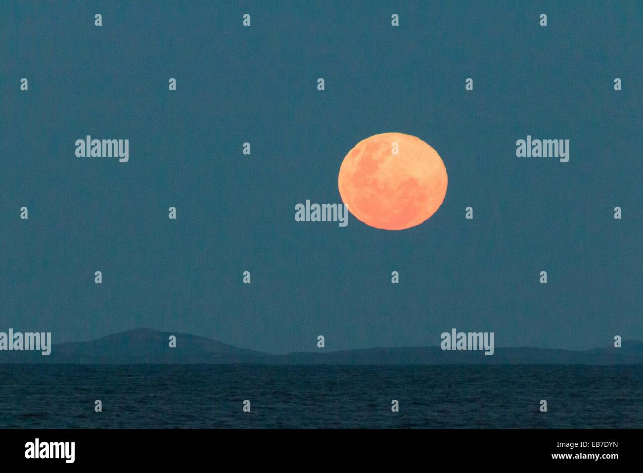 Moon Rise Over The Sea - Stock Image