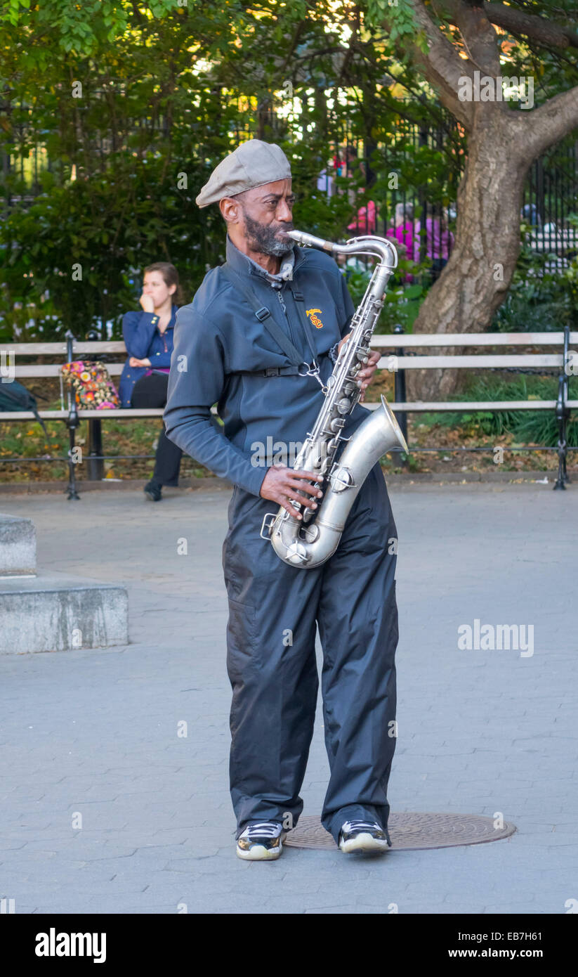 Jazz tenor saxophone player busking in Washington Square Park in Greenwich Village in New York City - Stock Image