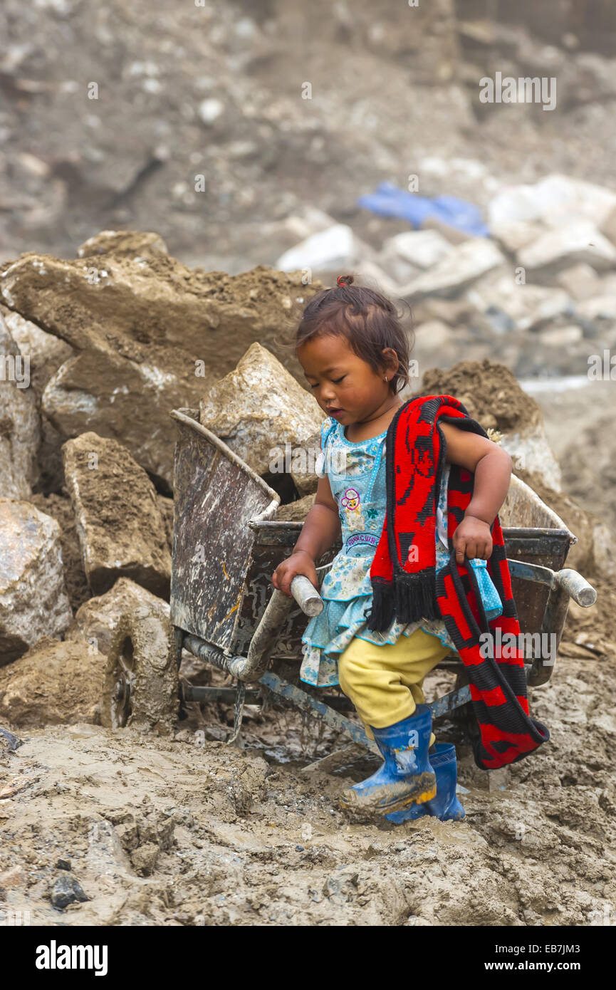 Nepalese mother and baby stock photos nepalese mother and baby little nepalese girl stays with her mother as she works at a construction site on rohtang ccuart Gallery