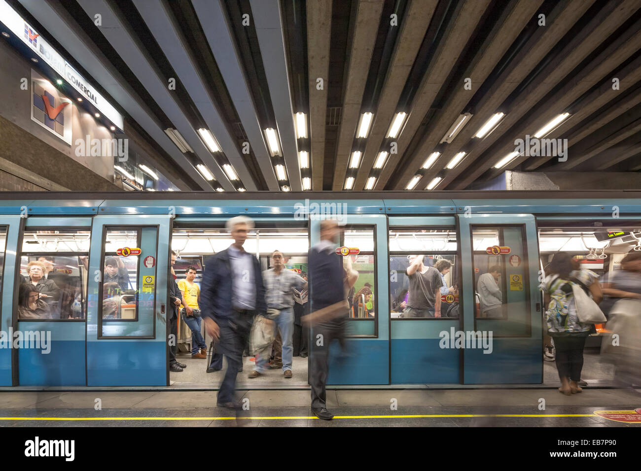Santiago de Chile commuters leaving and entering Metro train in subway station during rush hour. - Stock Image