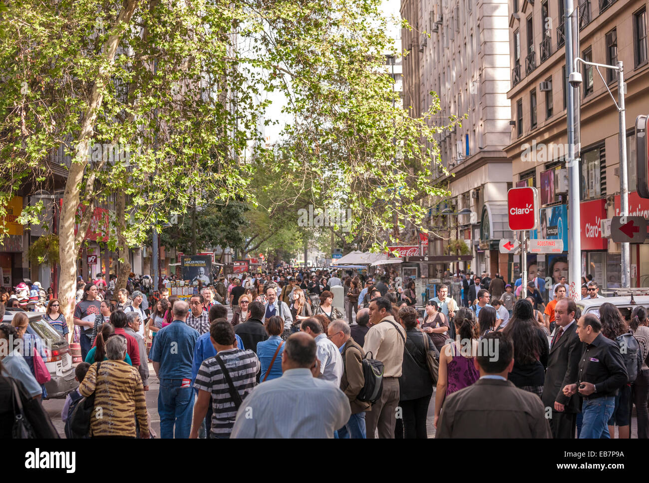 Santiago Chile, Paseo Ahumada. Crowds of people, shoppers, walking talking in the main shopping street of Santiago Stock Photo
