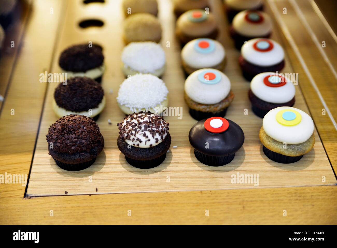 Mini-Cupcakes Displayed in a Glass Enclosed Case. - Stock Image