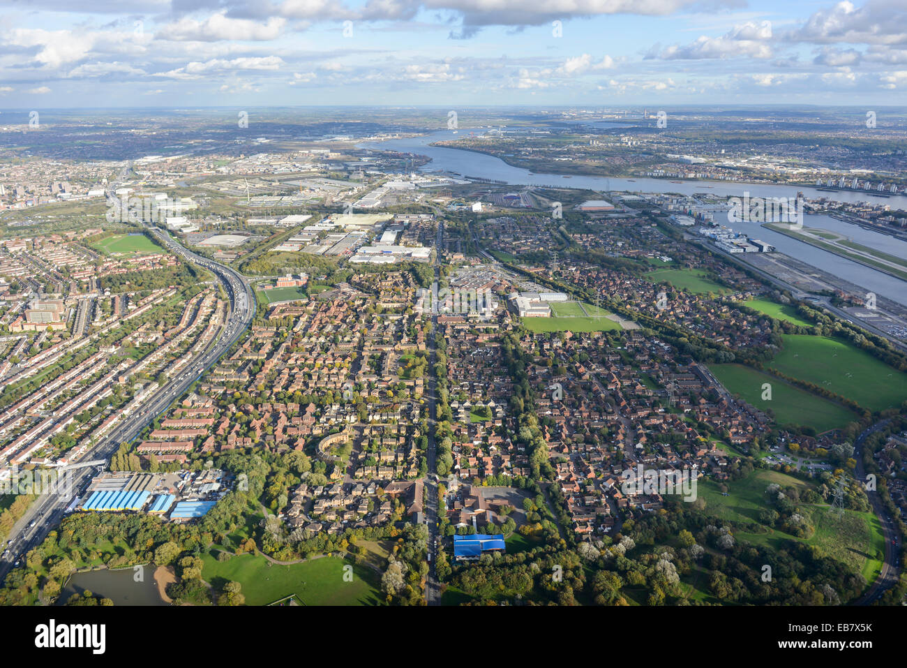 An aerial view of Beckton, an urban area of Newham, East London with the River Thames and Dartford visible in the - Stock Image