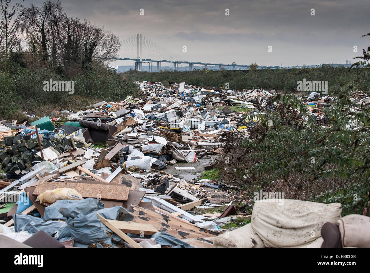 Purfleet, Essex. 27th November 2014.  Is this the biggest fly tip in the whole of the UK?  Stretching over 400 metres - Stock Image