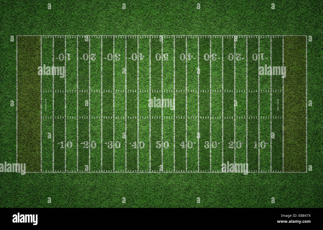 Green grass American football field with white lines marking the pitch. - Stock Image