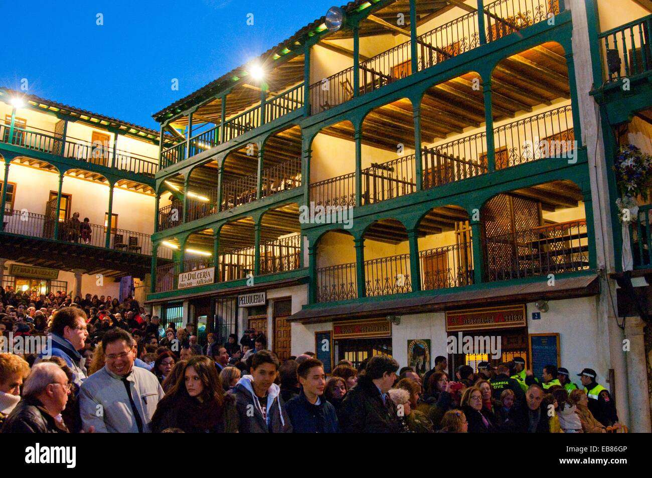 People in the Main Square before the Passion of Chinchon performance, night view. Chinchon, Madrid province, Spain. Stock Photo