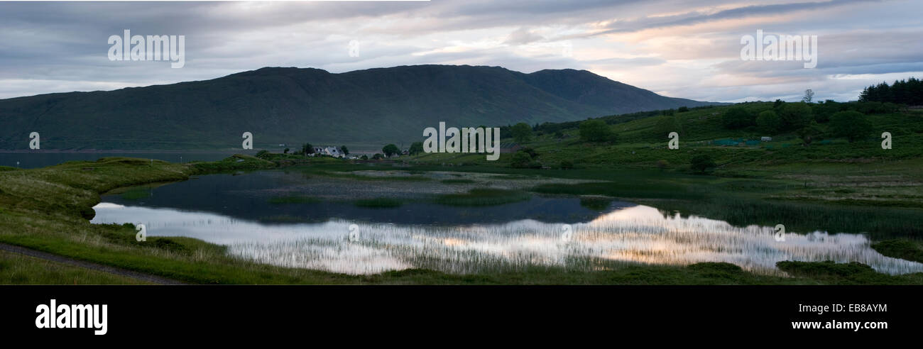 An evening sunset looking over a lochen in Applecross scotland - Stock Image