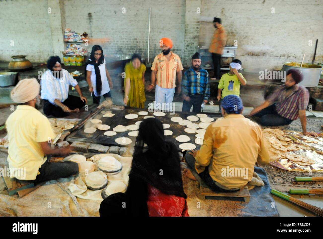 preparation of chapati in the canteen called Langar where food is served in a Gurdwara to all the visitors without - Stock Image
