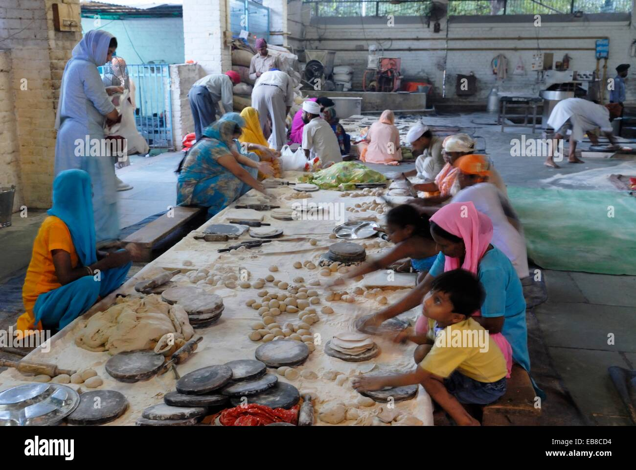 preparation chapati in the canteen called Langar where food is served in Gurdwara to all the visitors without distinction - Stock Image