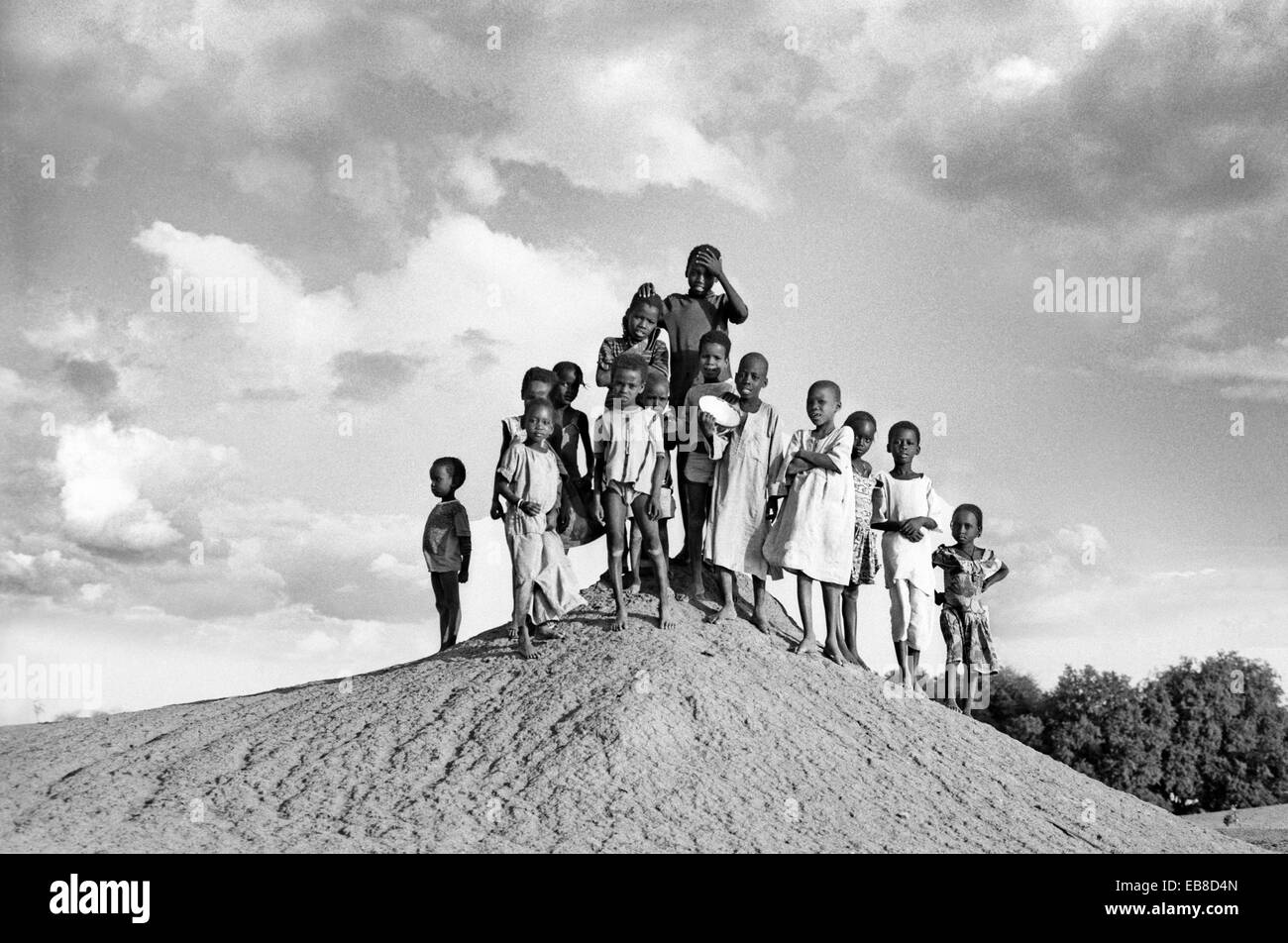 Group of kids outside a village next to the Lake Tchad, N´djamena, Chad, Central Africa - Stock Image
