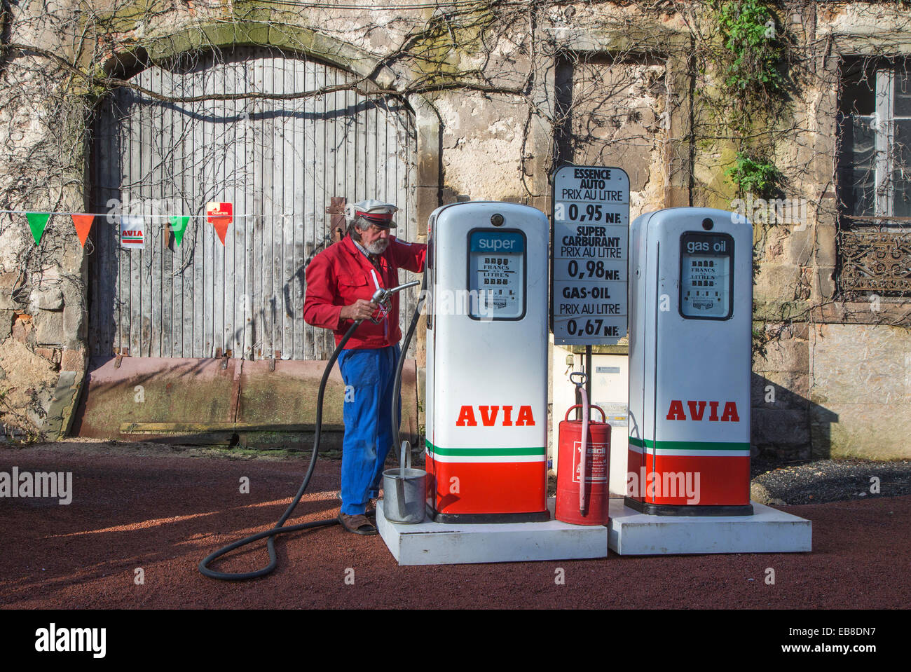 Antique Avia fuel pumps and service station attendant during the Embouteillage de la Route Nationale 7 at Lapalisse, - Stock Image