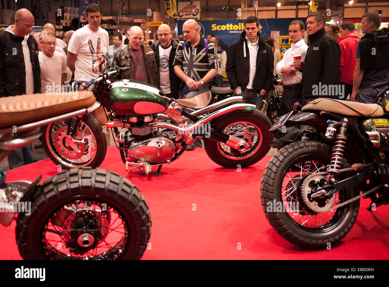 Visitors to the Motorcycle Live show at Birmingham's NEC, take a look at a custom Triumph motorcycle. - Stock Image