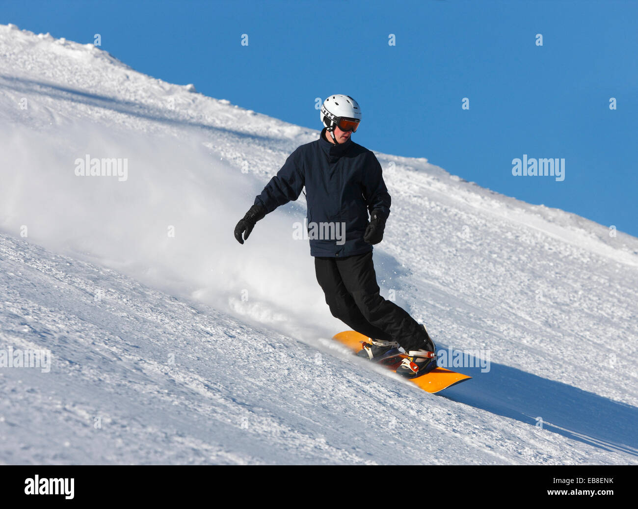 Snowboarder downhill - Stock Image