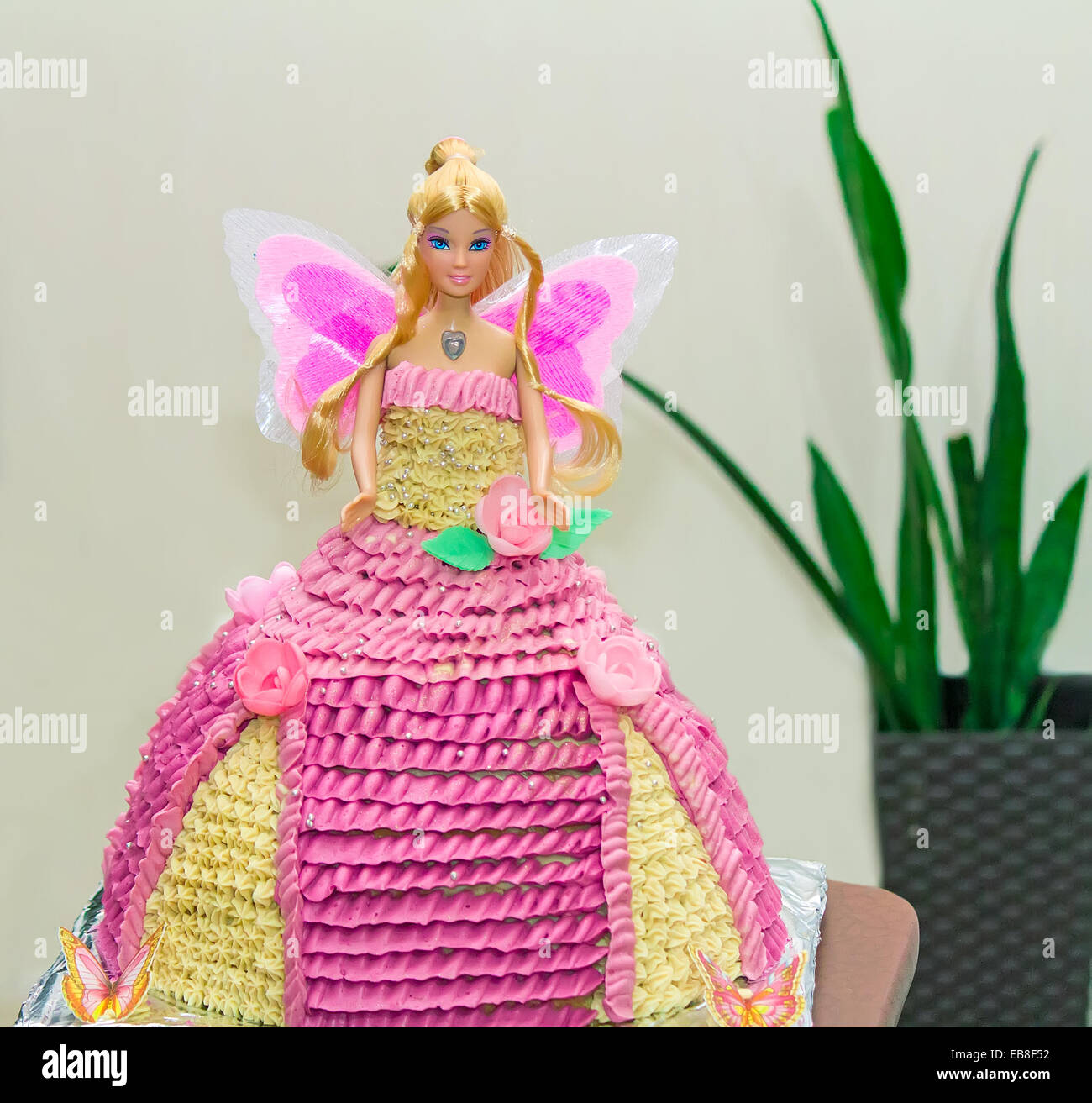 Beautiful birthday cake in the form of a doll in a wide dress made