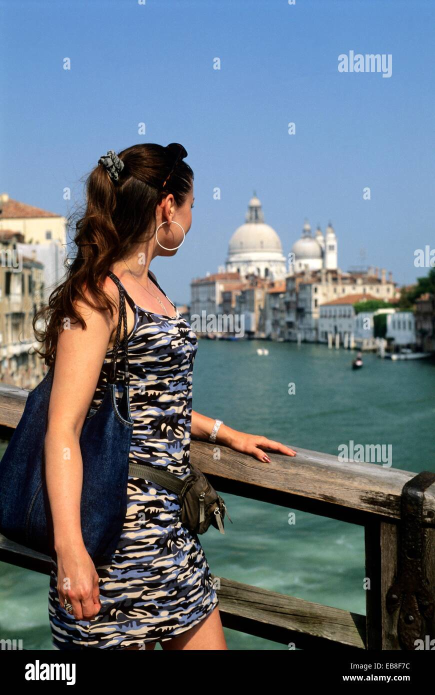 young woman on the Ponte dell´Accademia over the Grand Canal, Venice, Veneto region, Italy, Europe - Stock Image