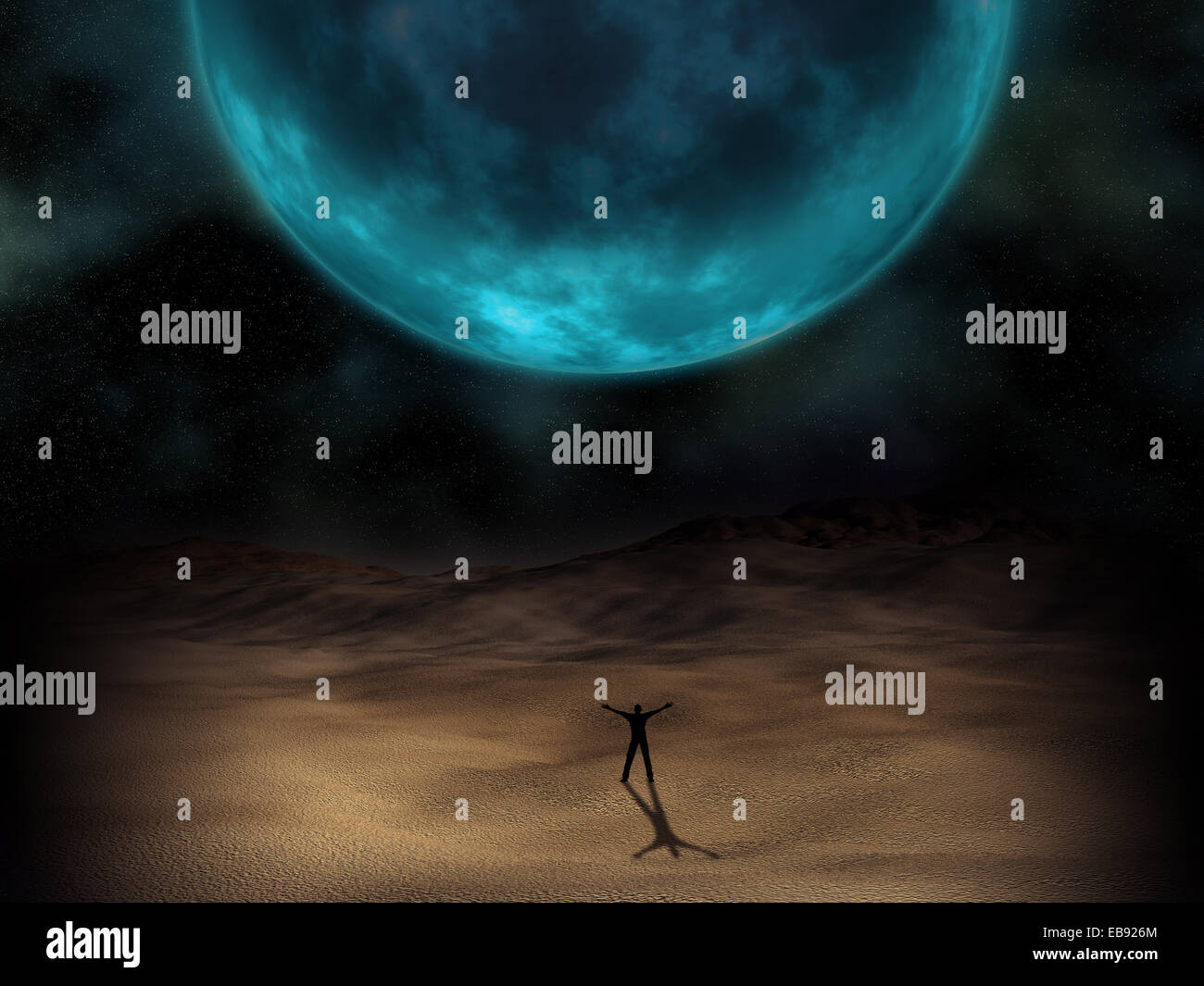 Silhouette of a man stood beneath a surreal planet Stock Photo