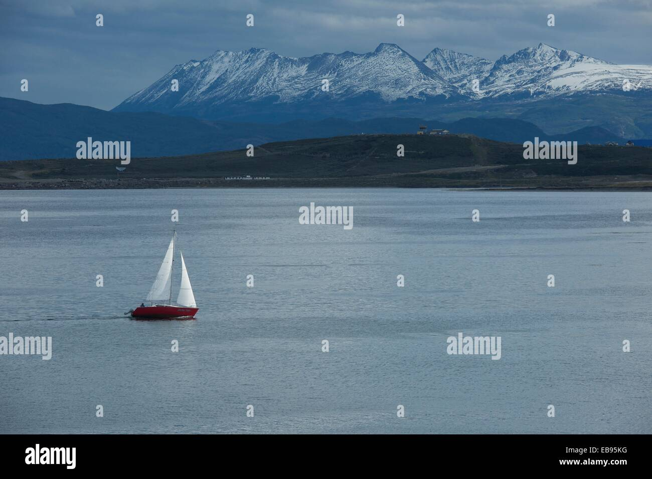 A sailboat plies the waters of the Beagle Channel, Tierra del Fuego, Argentina - Stock Image