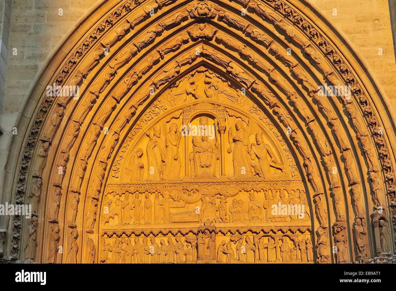 Notre Dame, at sunset, detail of Portal of Saint Anne. Paris, France. Stock Photo