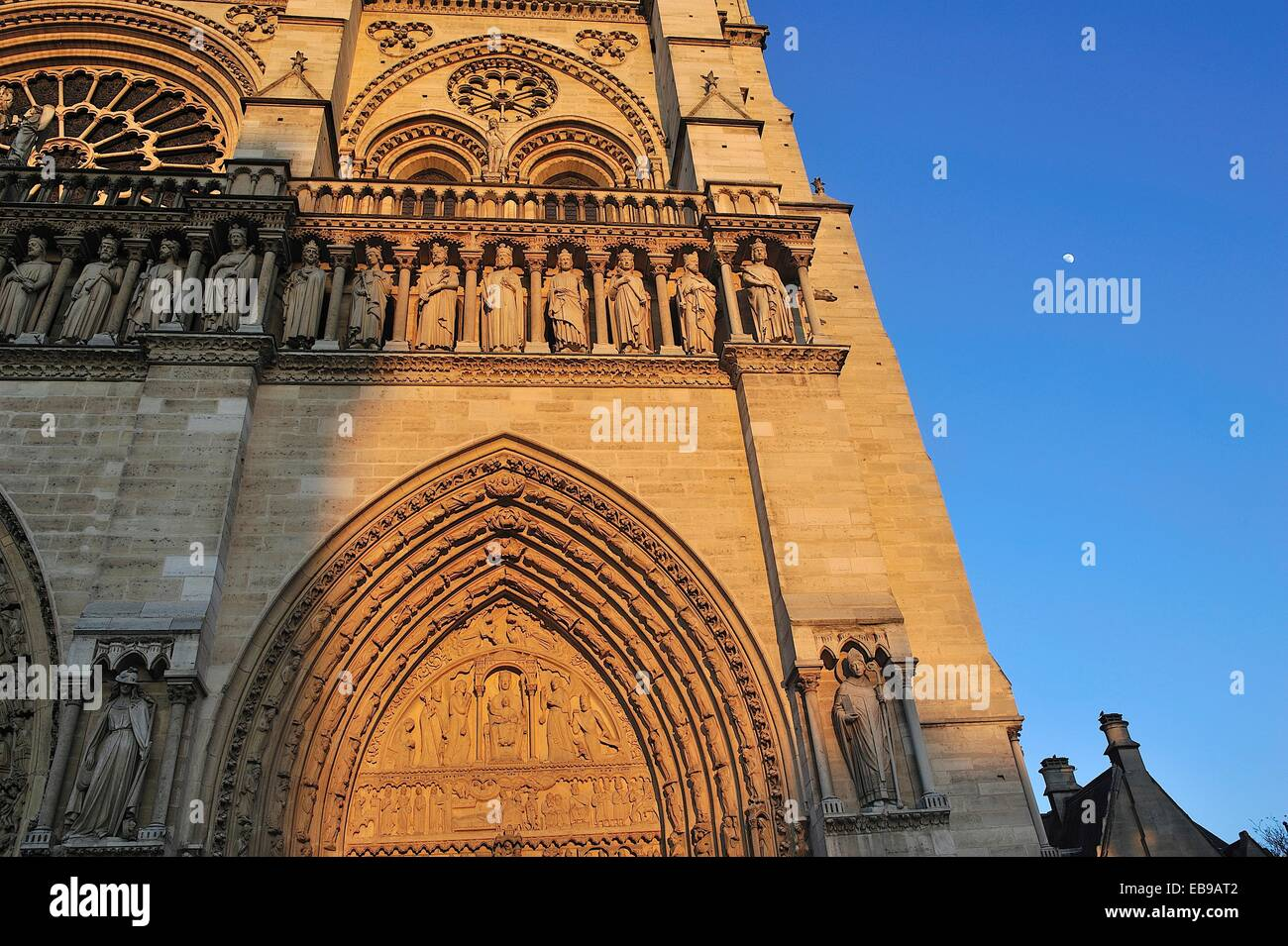 Notre Dame, at sunset, Portal of Saint Anne. Paris, France. Stock Photo