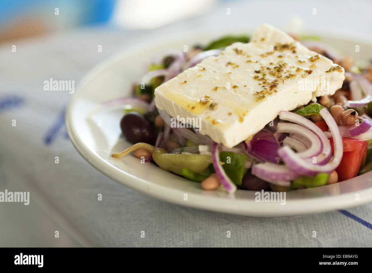 Greek Salad wiating to consume on the table, Koufonissi, Cyclades Islands, Greek Islands, Greece, Europe. - Stock Image