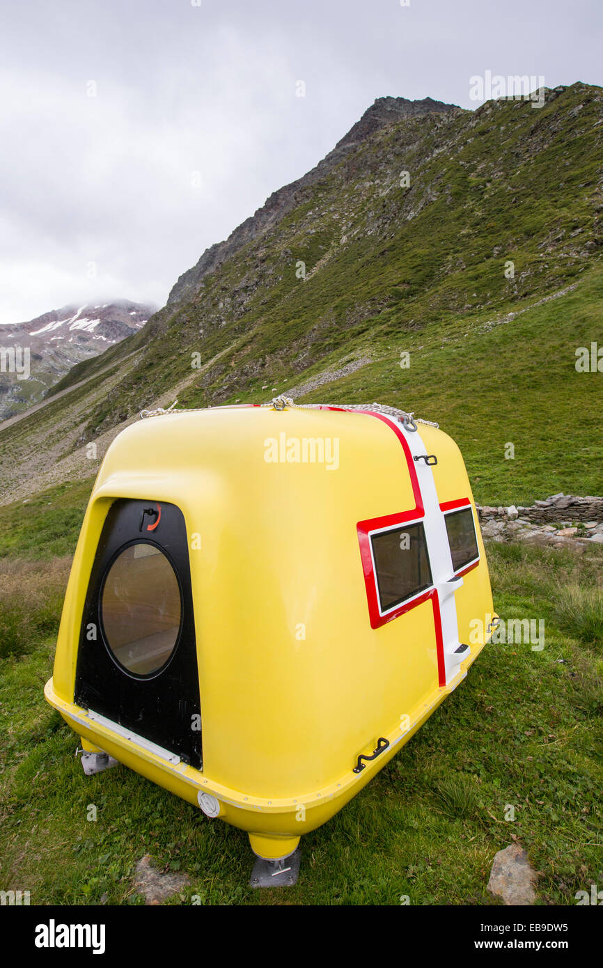 An emergency shelter for the Ultra Trail Tour Du Mont Blanc mountain race on the Col du Tricot - Stock Image