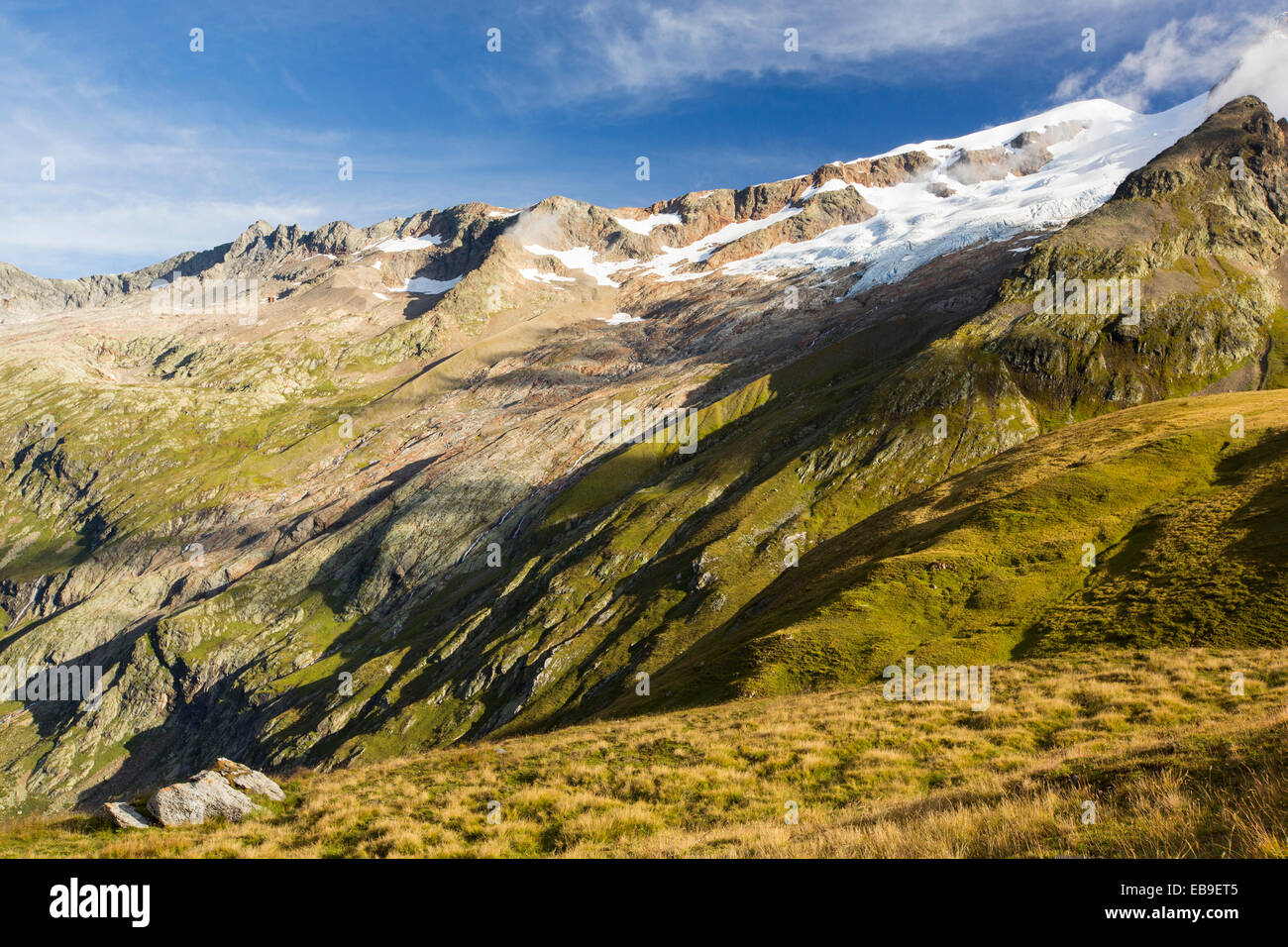 The rapidly retreating Glacier des glaciers on the Aig des Glaciers, part of the Mont Blanc range. The lateral moraines - Stock Image