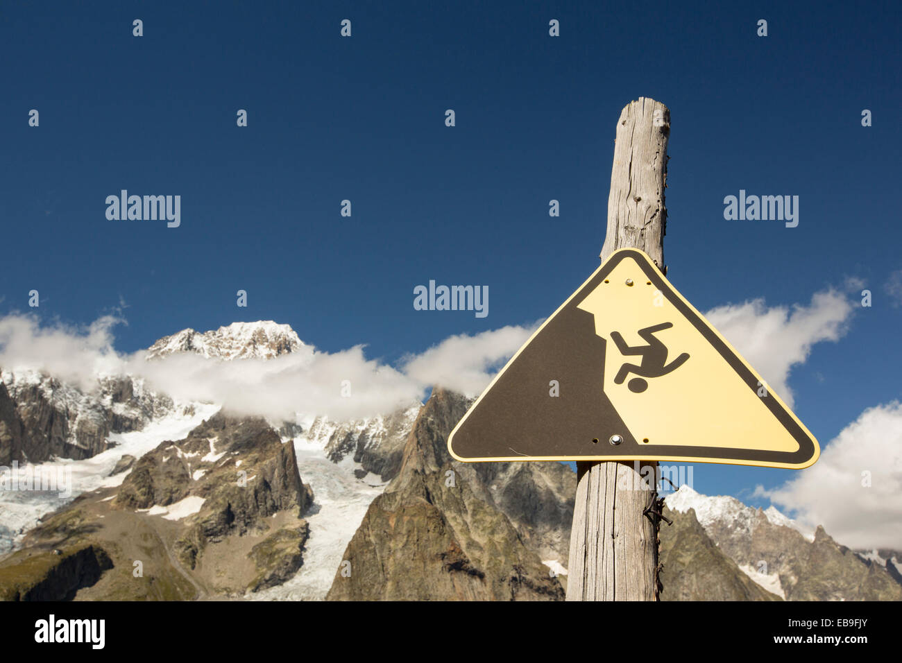 Looking towards Mont Blanc and the Glacier du Miage from above Val Veny, Italy, with a warning sign for skiers. - Stock Image