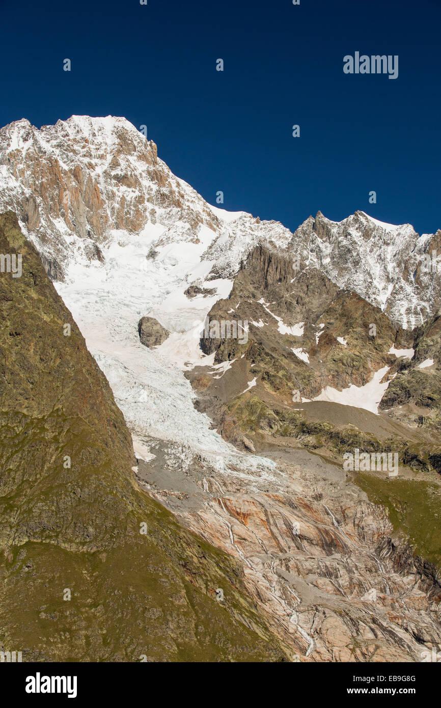 The rapidly retreating Glacier De La Lex Blanche on the Aiguille De Tre La Tete in the Italian Alps on the Tour - Stock Image