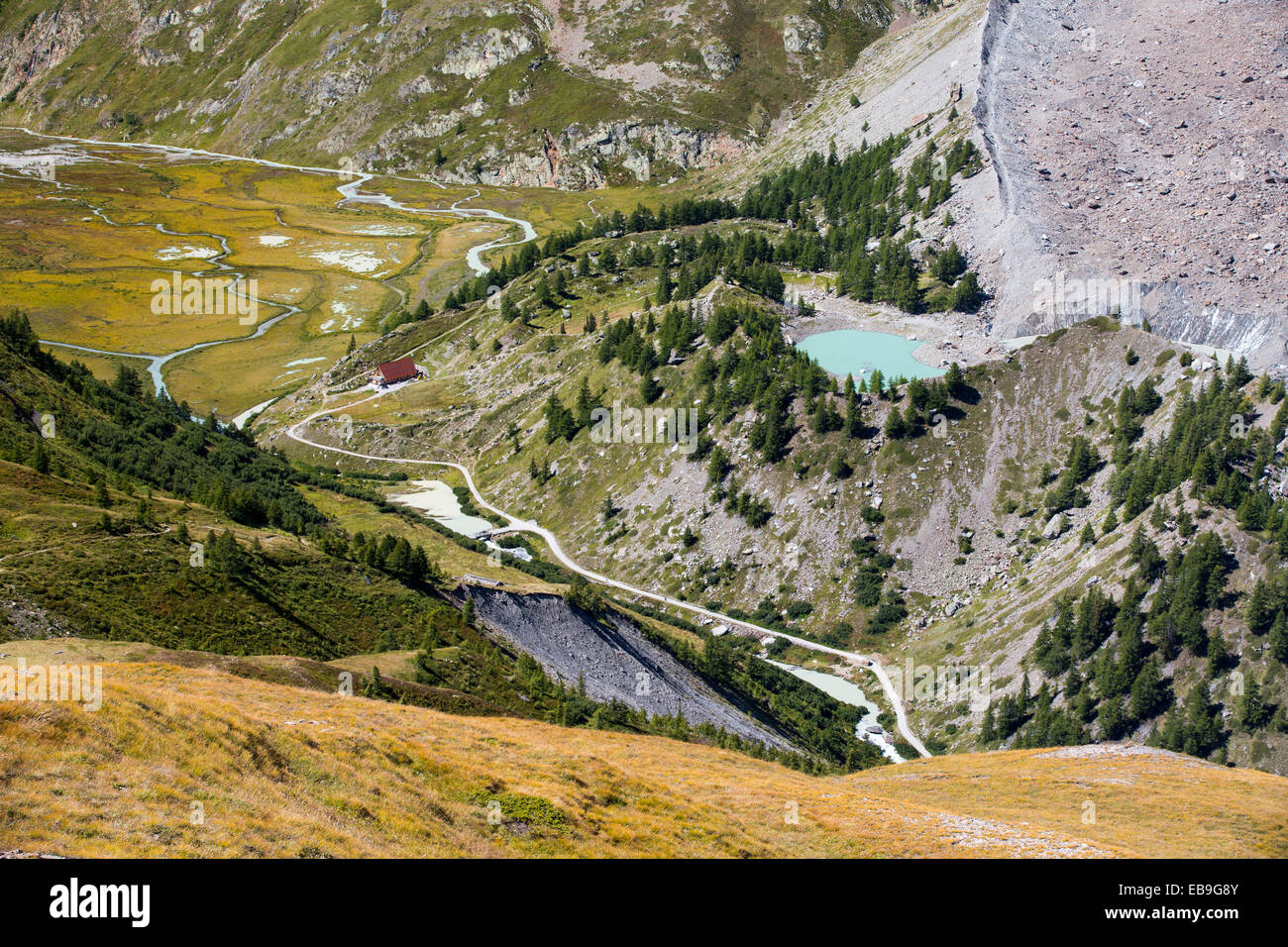 A meltwater lake on the side of the rapidly retreating Glacier du Miage, below Mont Blanc du Courmayeur. - Stock Image