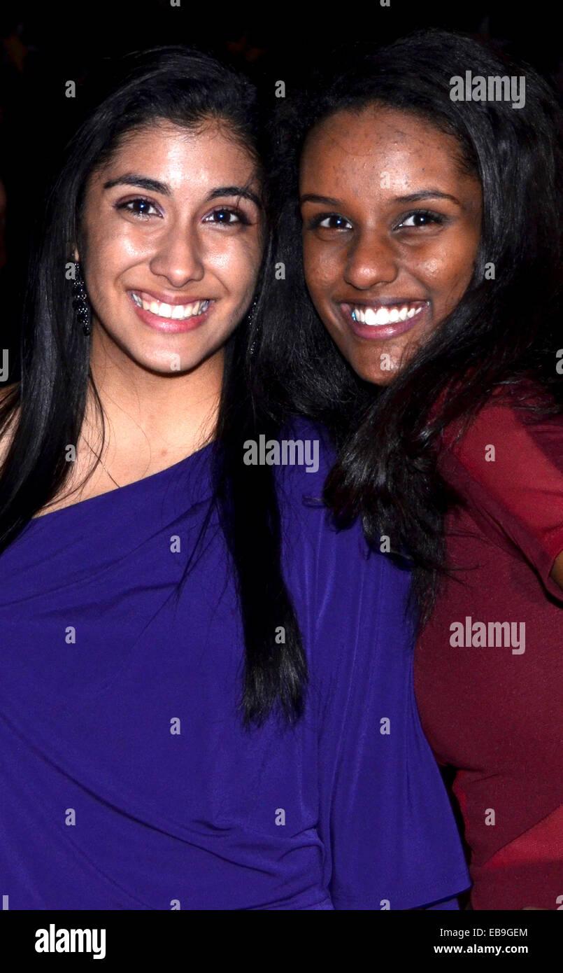 teenage interracial friends smiling - Stock Image