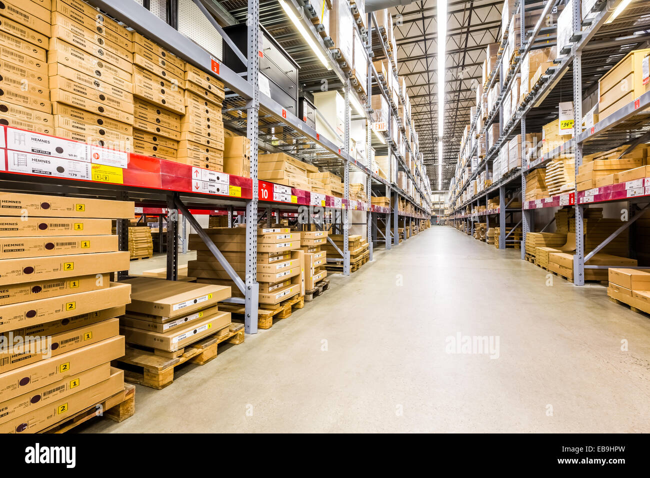 Warehouse aisle in an IKEA store - Stock Image