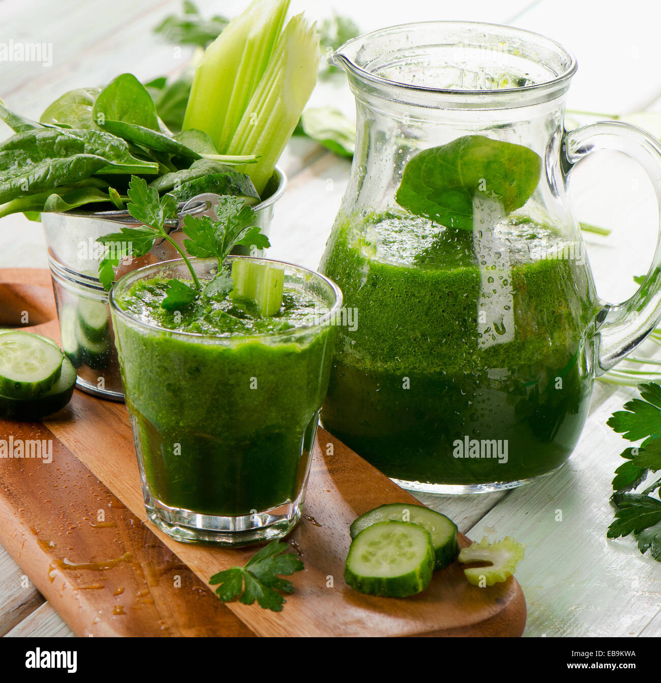 Healthy green smoothie on a wooden table. Selective focus - Stock Image