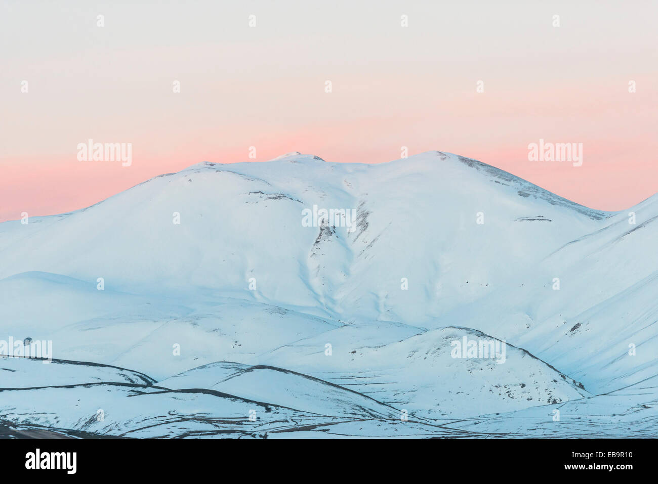 Sunset in winter, Monti Sibillini National Park, Castelluccio di Norcia, Umbria, Italy - Stock Image
