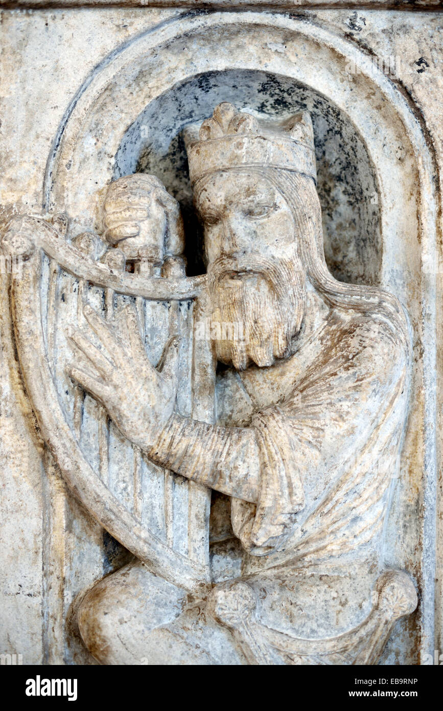 King David, 2nd King of Israel & Judah, Tuning His Harp Romanesque Sculpture Capital or Stone Carving Musée - Stock Image