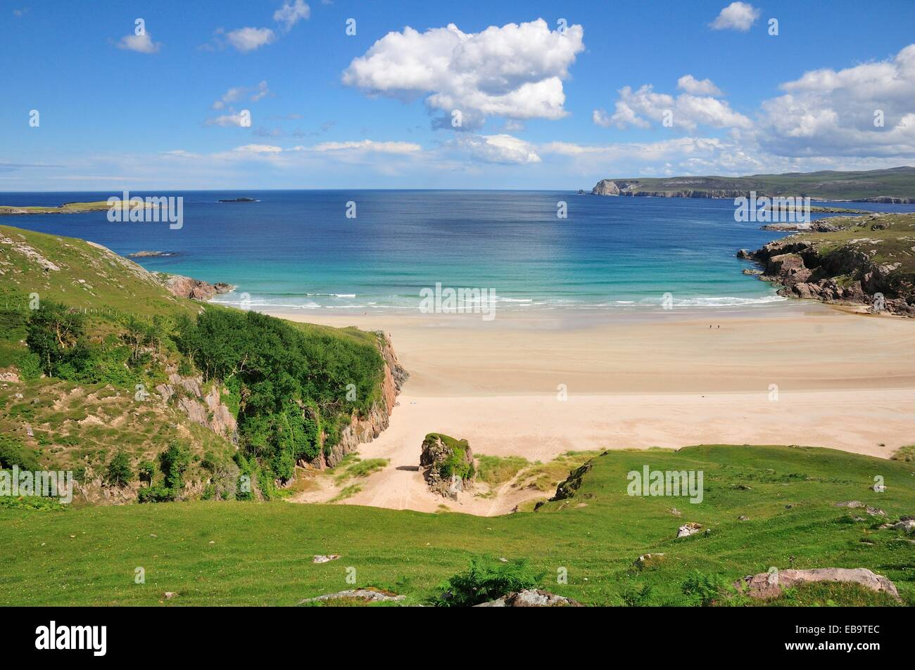 Sandy beach and rocks in Rispond Bay, Durness, Caithness, Sutherland and Easter Ross, Scotland, United Kingdom - Stock Image