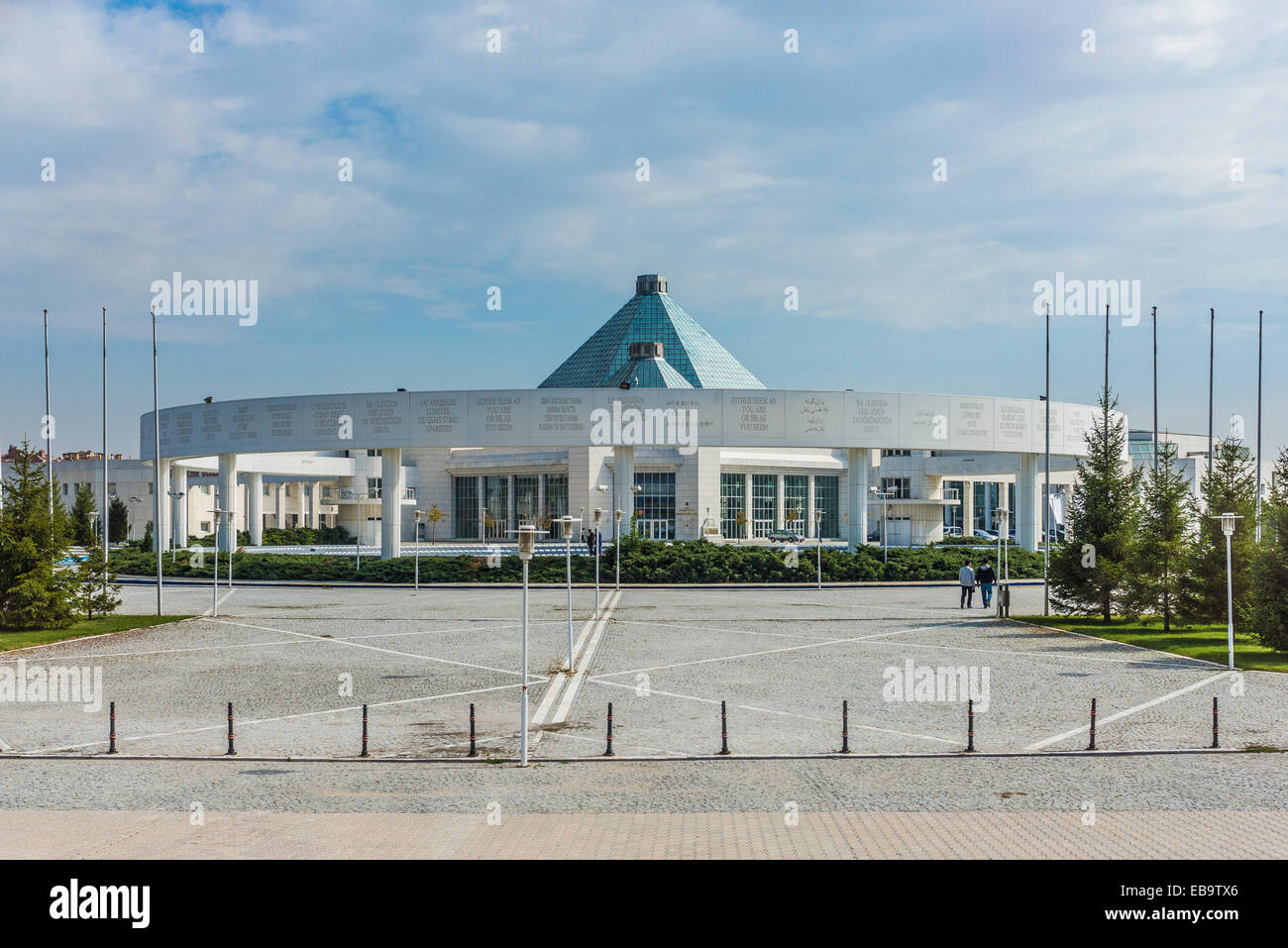 Mevlana Cultural Centre, façade with writing in many languages 'show yourself either as you are or be - Stock Image