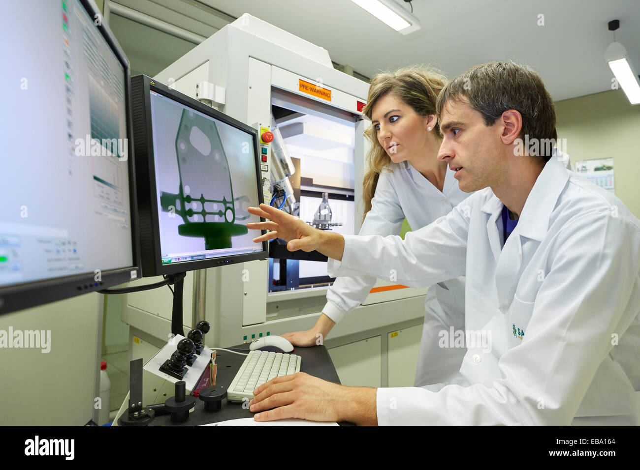 XTH 225. Computed tomography system. Industrial X-ray. Technicians inspect the internal structure and porosity of - Stock Image