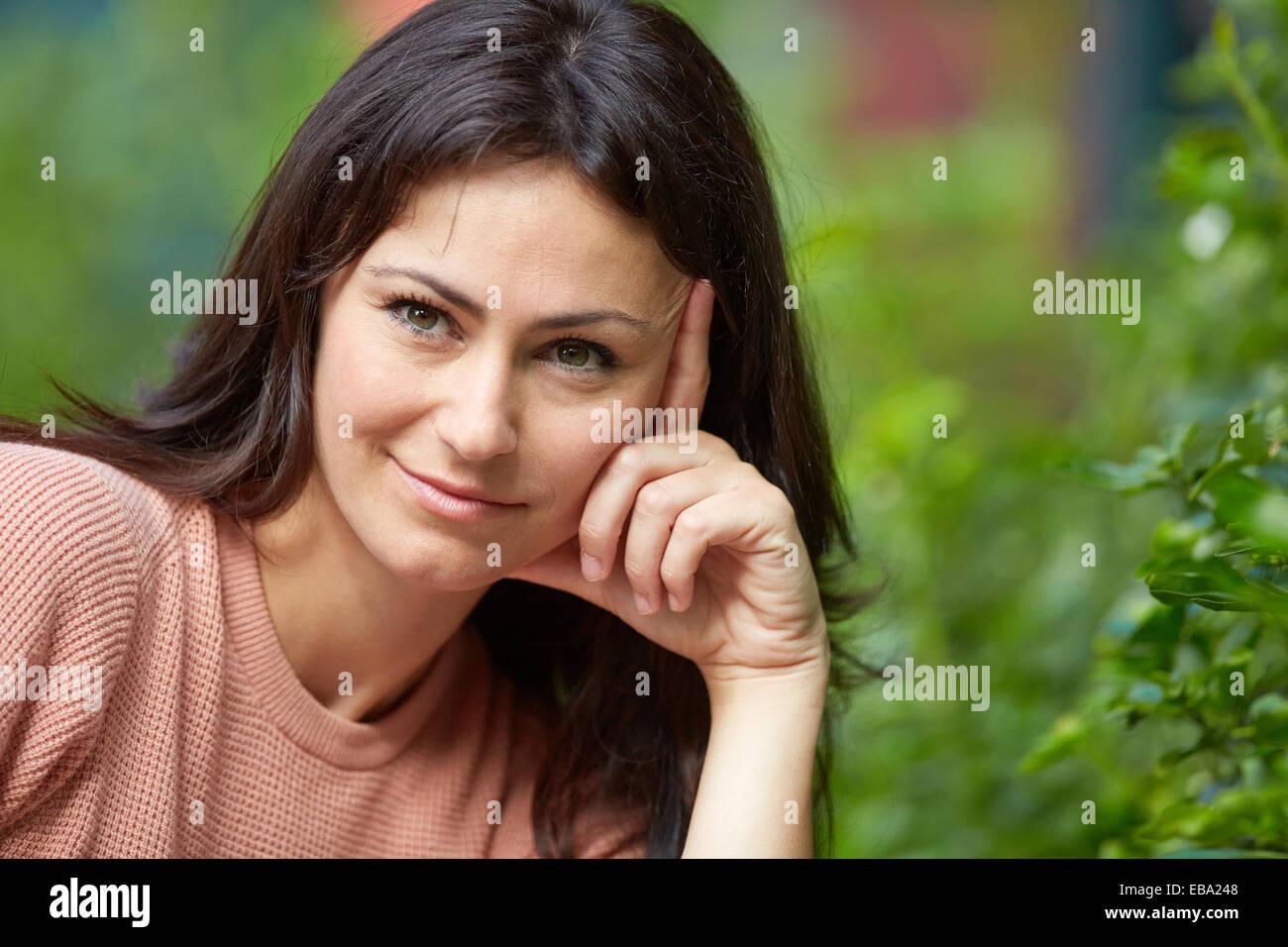 35 year old woman in a park. Donostia. San Sebastian. Gipuzkoa. Basque Country, Spain. - Stock Image