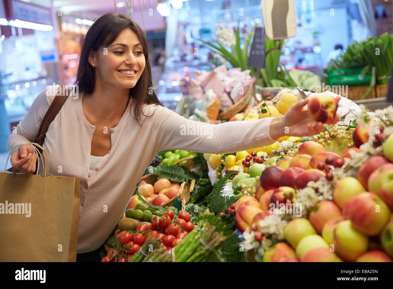 35 Year Old Woman Buying Fruit. Shopping At The Bretxa
