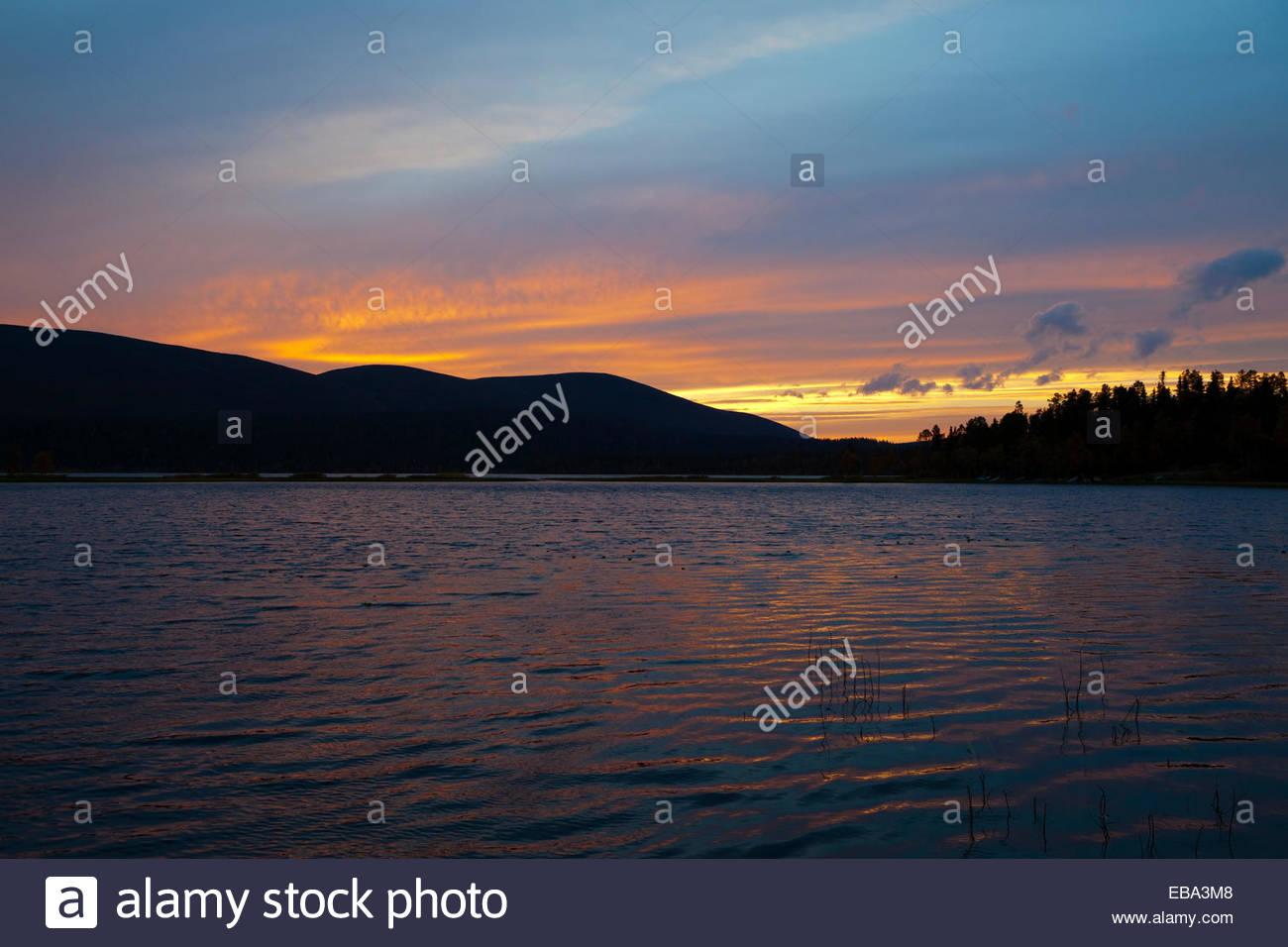 Red sunset at lake Vuontisjärvi in Lapland - Stock Image