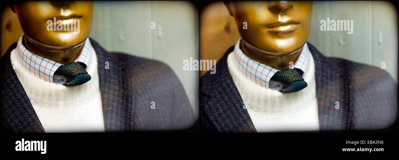 foreground of a doubled portrait of a mannequin in a shop window in London, England - Stock Image