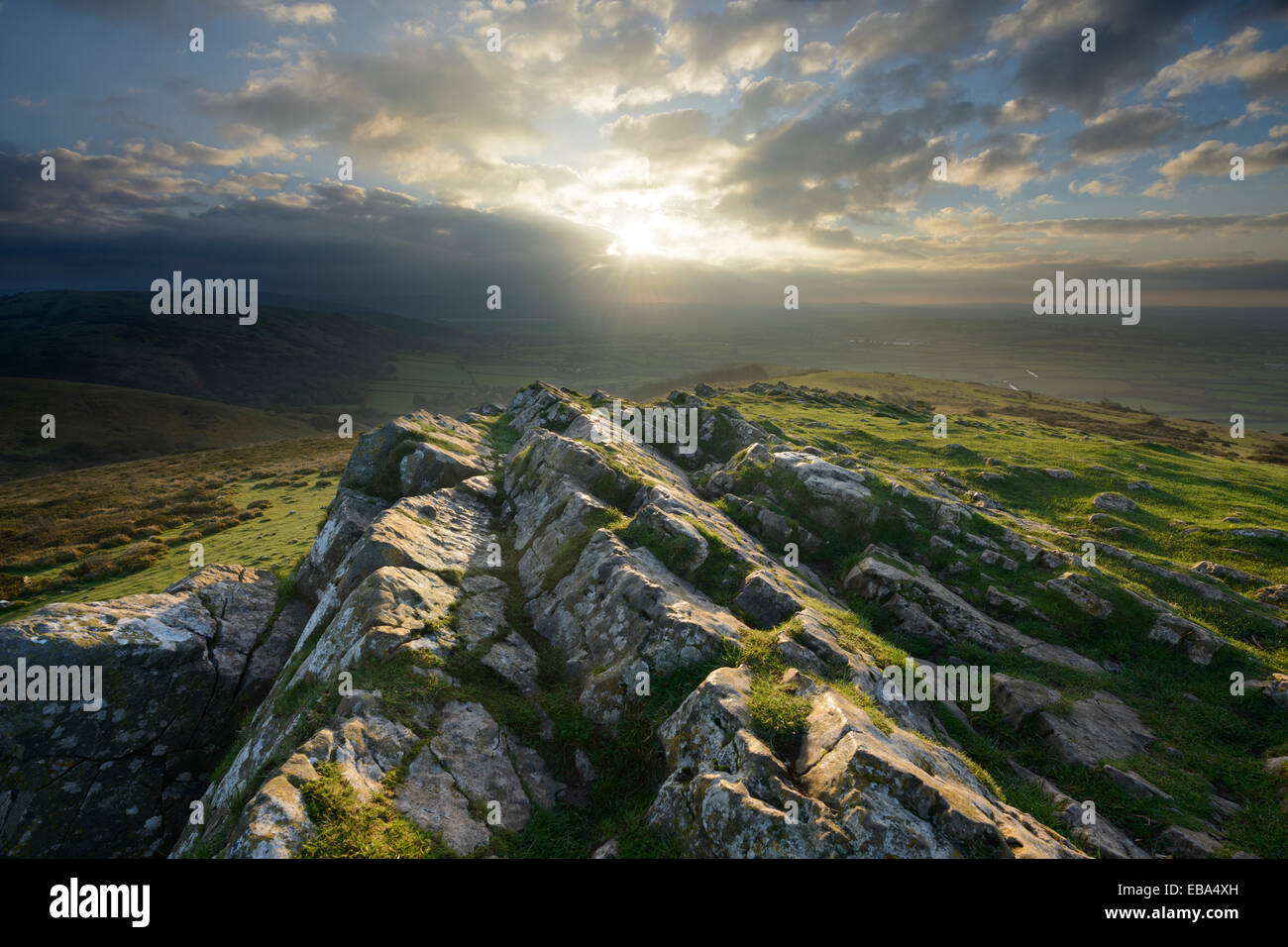 The distinctive rocky peak of Crook Peak bathed in sunshine on the Mendip Hills, Somerset. - Stock Image