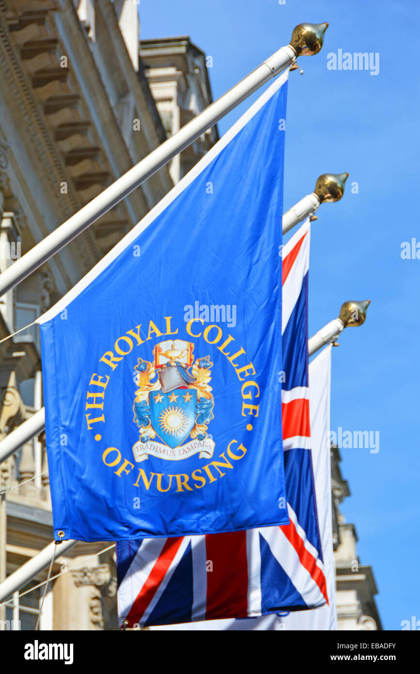 The Royal College of Nursing headquarters building & flag with Union Jack beyond London England UK - Stock Image