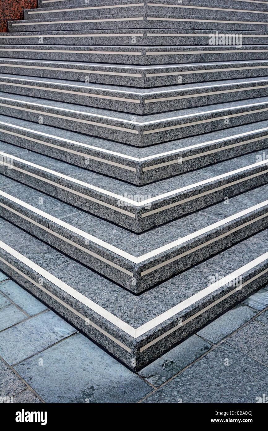 Stone steps at entrance to elevated public walkway leading to office building entrance London England UK - Stock Image