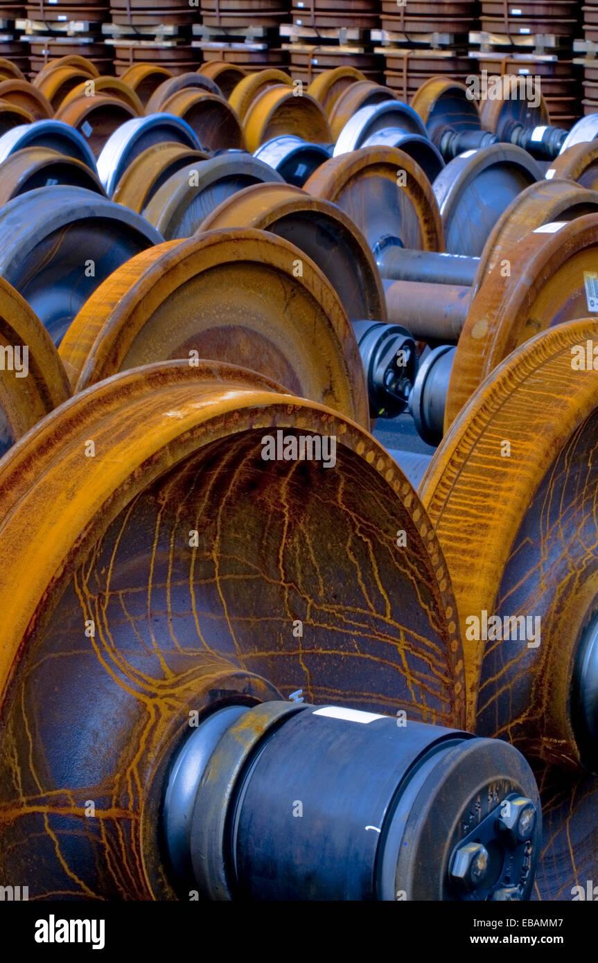 Railroad train wheel and axle assemblies at manufacturing plant Tacoma Washington USA. - Stock Image
