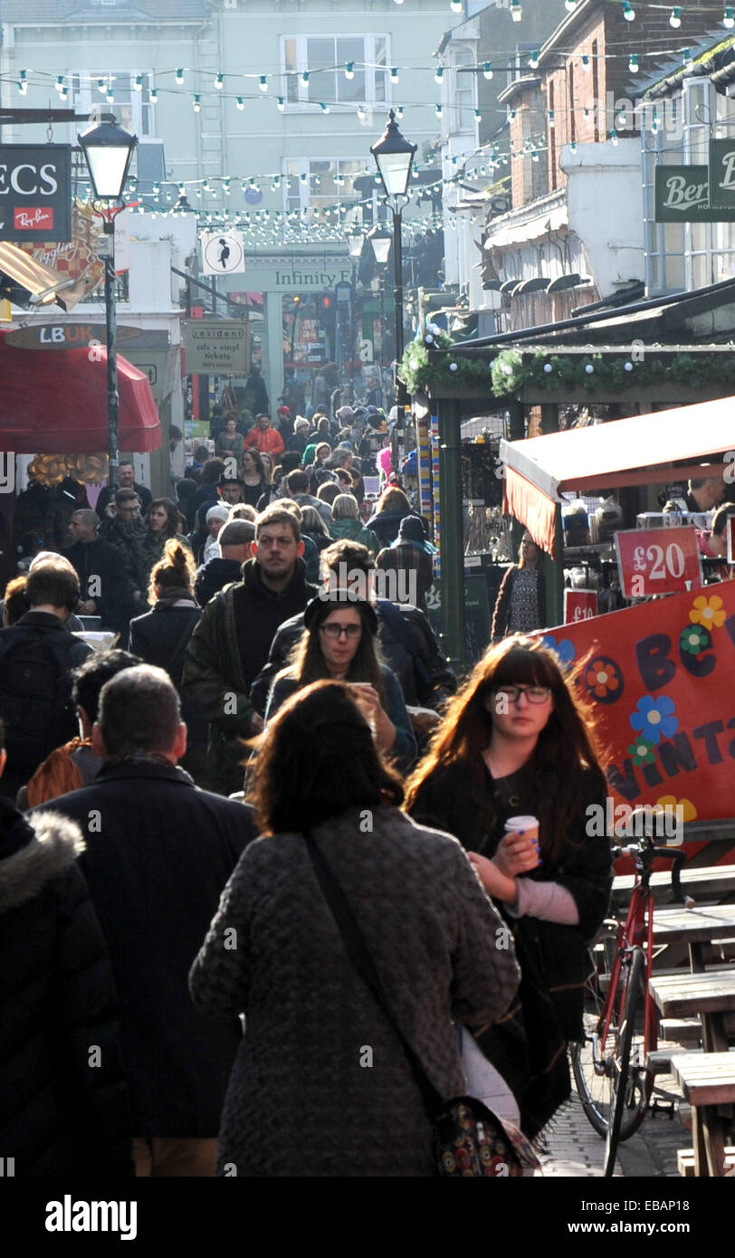 Shoppers crowd into the bohemian North Laine district of Brighton today on the look out for Christmas bargains on Stock Photo