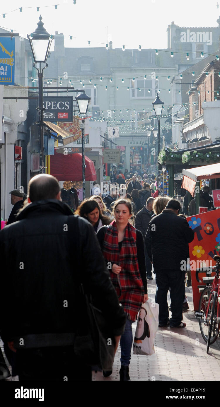 Shoppers crowd into the bohemian North Laine district of Brighton today on the look out for Christmas bargains on - Stock Image